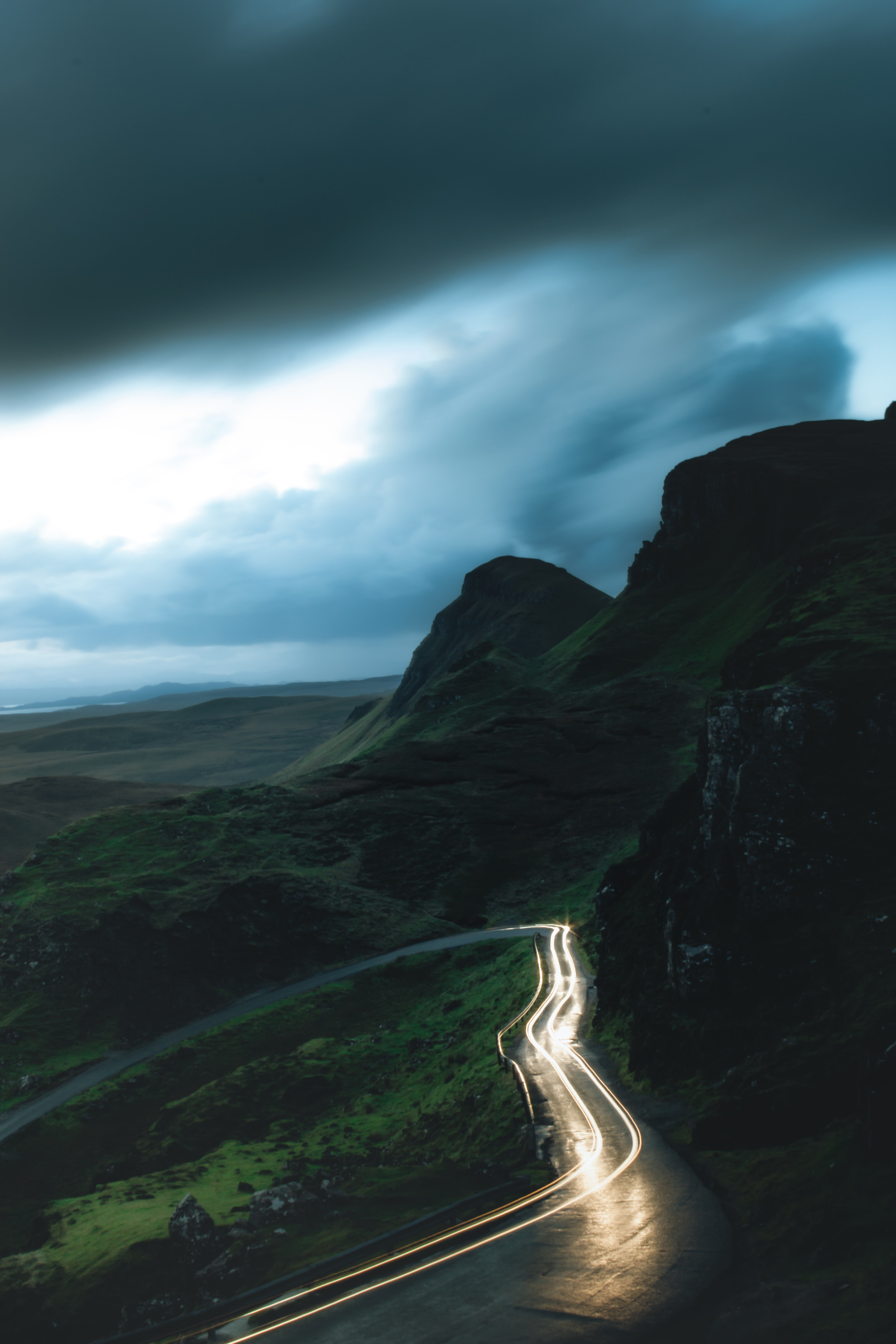 lighted-car-in-winding-road-2324925